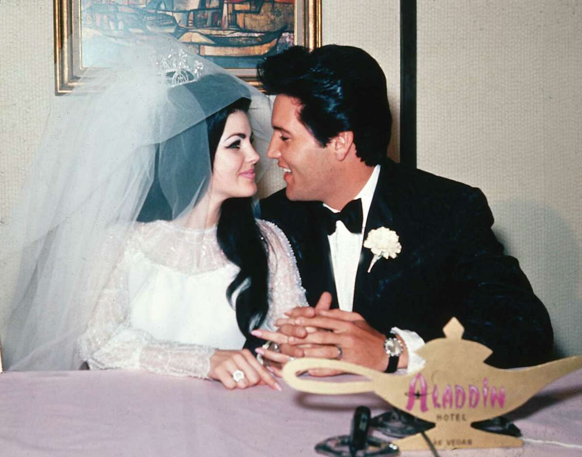 In this May 1, 1967 photo, singer Elvis Presley and his bride, the former Priscilla Beaulieu, appear at the Aladdin Hotel in Las Vegas, after their wedding.