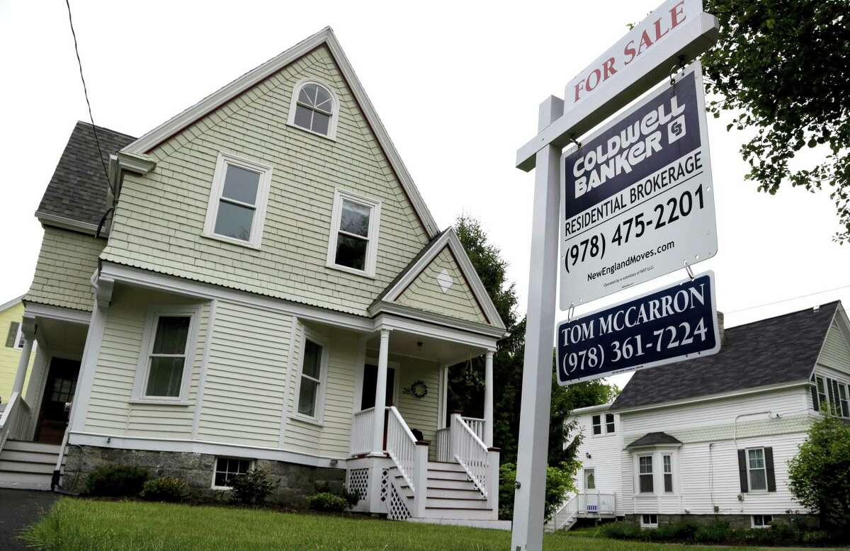 This Tuesday, May 24, 2016, photo shows a home for sale in Andover, Mass. On Tuesday, June 28, 2016, the Standard & Poor's/Case-Shiller 20-city home price index for April is released.