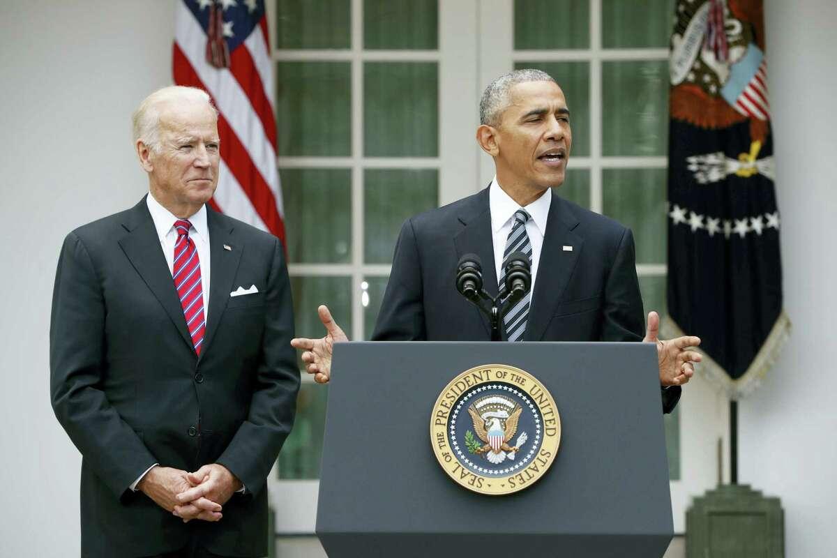 President Barack Obama, accompanied by Vice President Joe Biden, speaks in the election on Wednesday, Nov. 9, 2016 in the Rose Garden of the White House in Washington.
