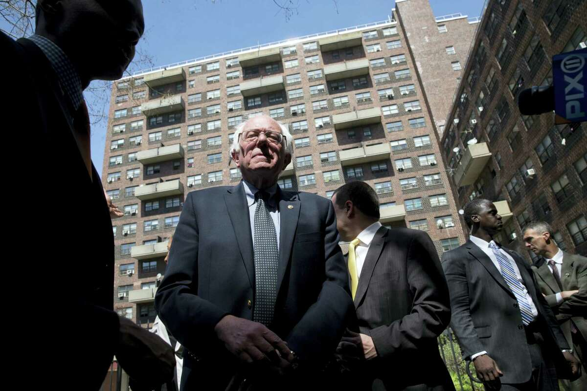 Democratic presidential candidate Sen. Bernie Sanders of Vermont speaks to reporters after touring the Twin Parks housing projects, Monday in the Bronx borough of New York.