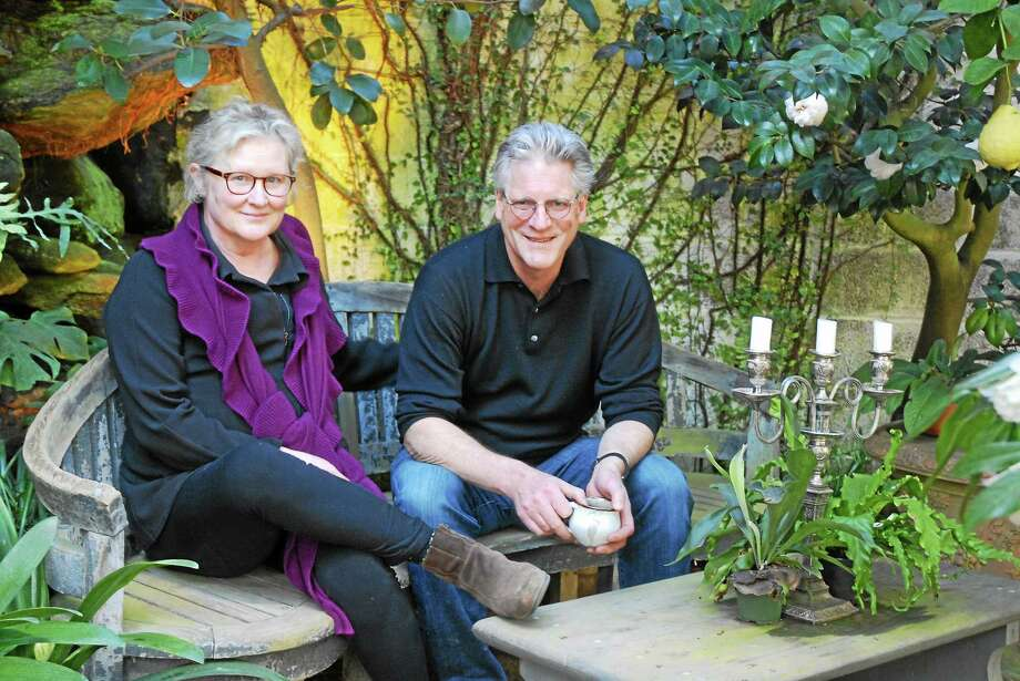 Barbara and Peter Talbot in the greenhouse. Photo: Tovah Martin — Special To The Register Citizen