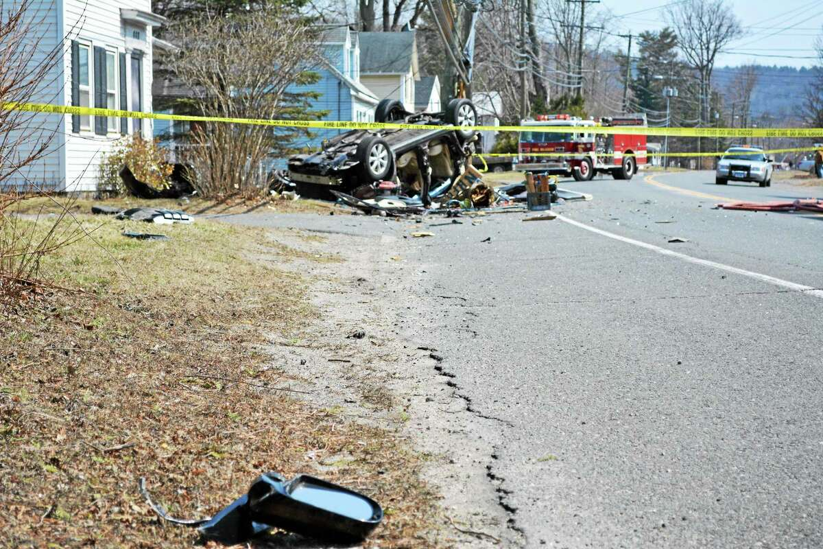 A car crashed into a telephone pole on Route 44 in New Hartford, snapping it in half, then flipped and rolled into a nearby house.