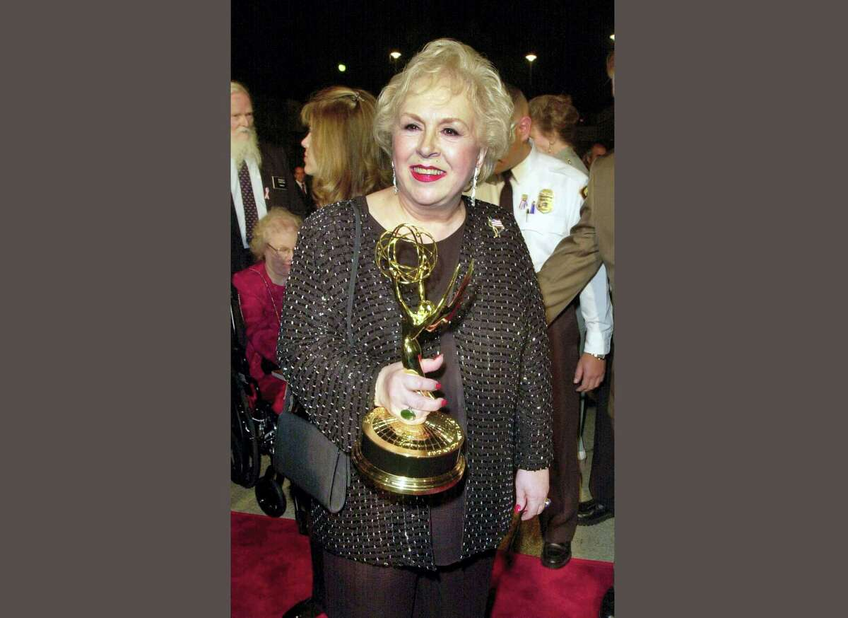 """FILE - In this Nov. 4, 2001 file photo, Doris Roberts holds her Emmy for outstanding supporting actress in a comedy series for her work on """"Everybody Loves Raymond"""" following the 53rd annual Primetime Emmy Awards in Los Angeles. Family spokeswoman said Monday, April 18, 2016, that Roberts died overnight Sunday in her sleep in Los Angeles. She was 90. (AP Photo/Kim D. Johnson, File)"""