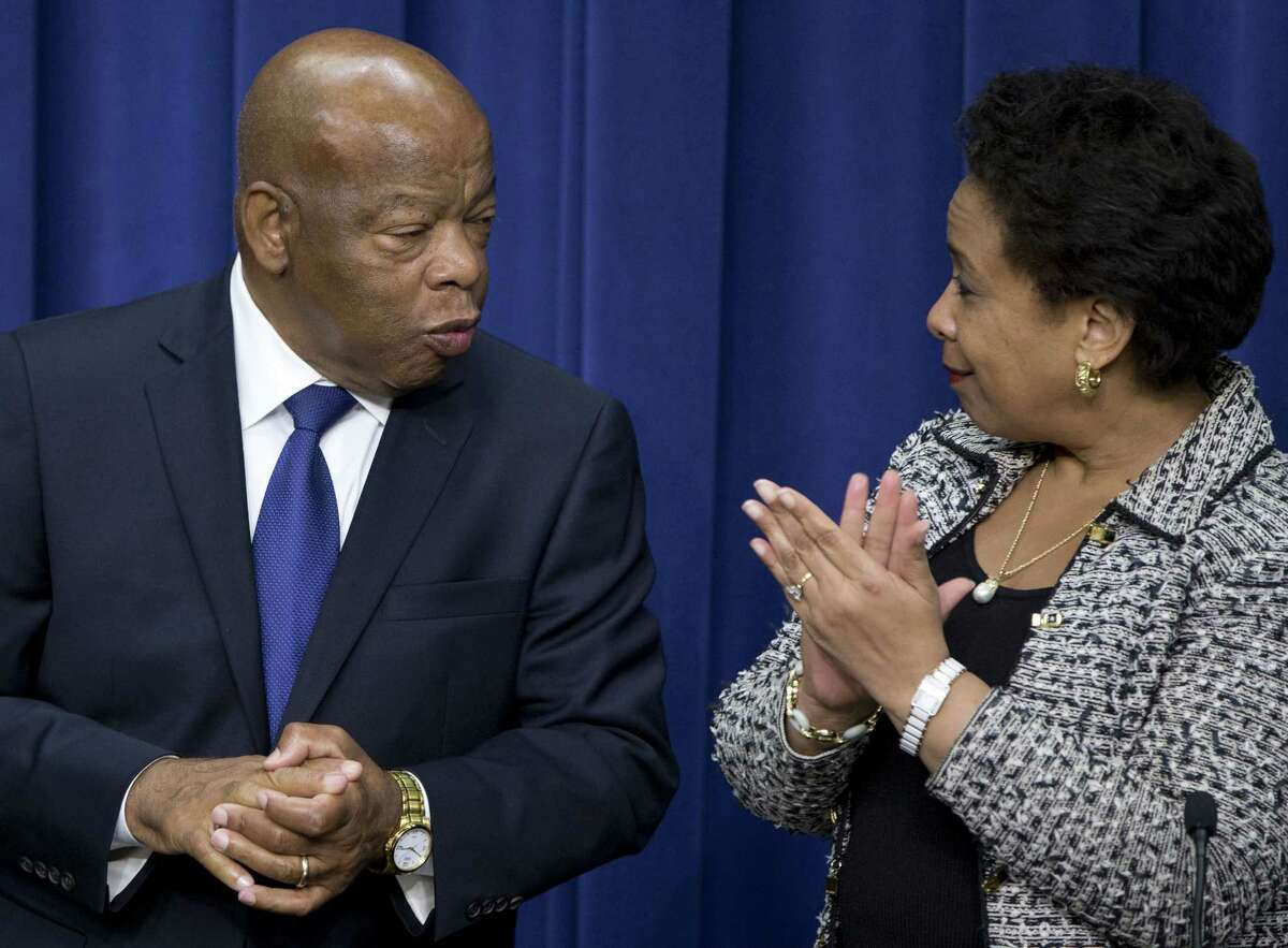 Attorney General Loretta Lynch, and Rep. John Lewis, D-Ga., stand on stage together in the South Court Auditorium in the Eisenhower Executive Office Building on the White House complex Thursday after President Barack Obama spoke about the 50th anniversary of the Voting Rights Act.
