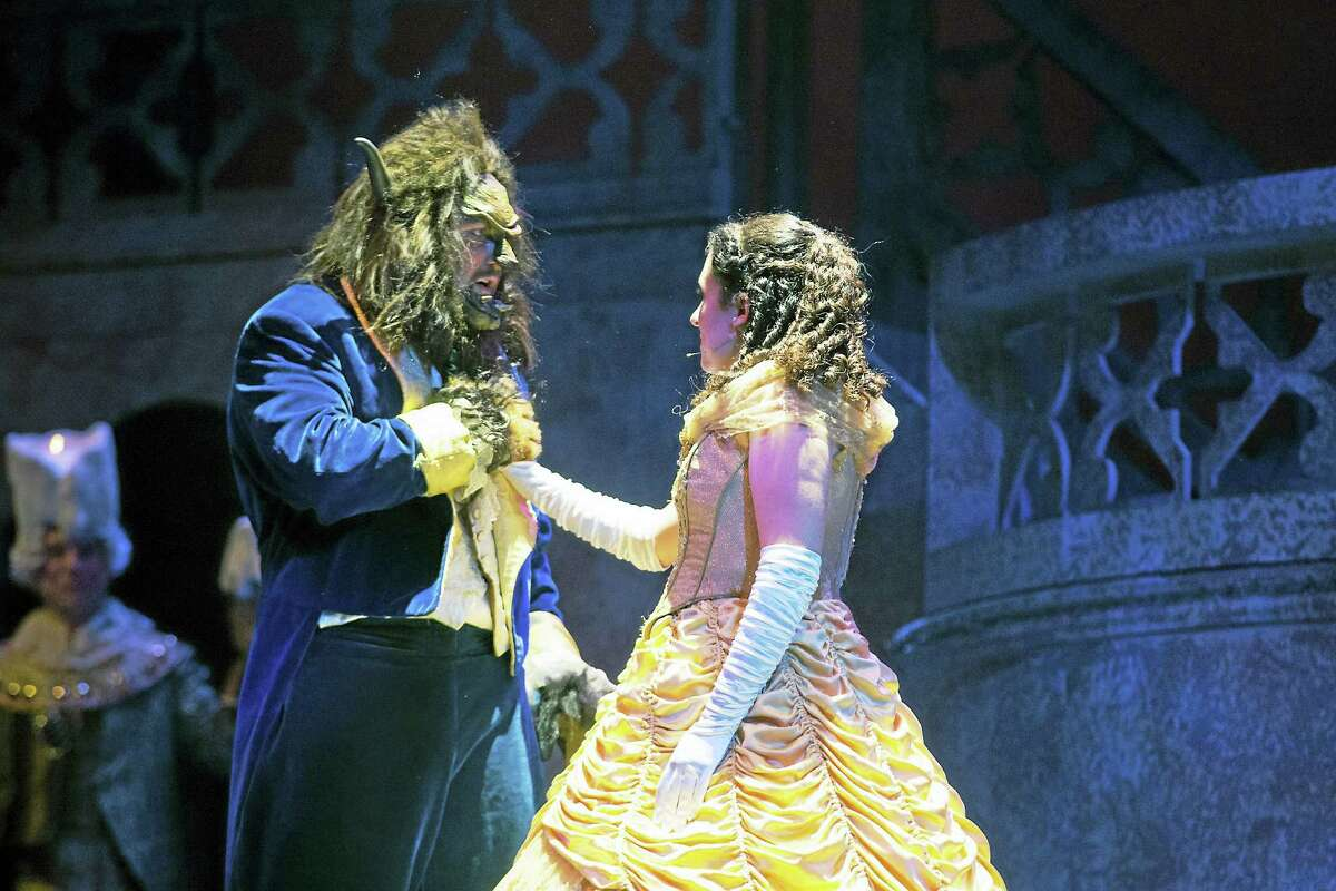 Photos by Mandi Martini Caitlin Mandracchia as Belle, and Tyler Reid von Oy as the Beast, in a scene from the musical at the Warner Theatre.