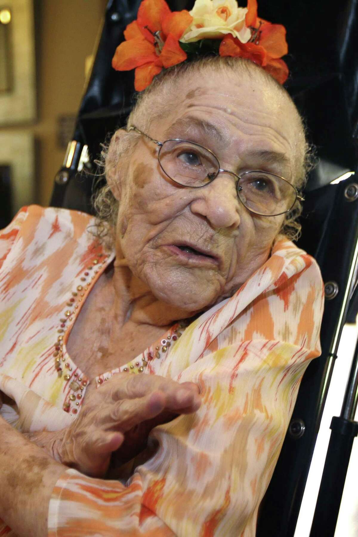 In this July 3, 2014, file photo, Gertrude Weaver poses at Silver Oaks Health and Rehabilitation Center in Camden, Ark., a day before her 116th birthday. Just days after becoming the world's oldest documented person, 116-year-old Gertrude Weaver died Monday in Arkansas.