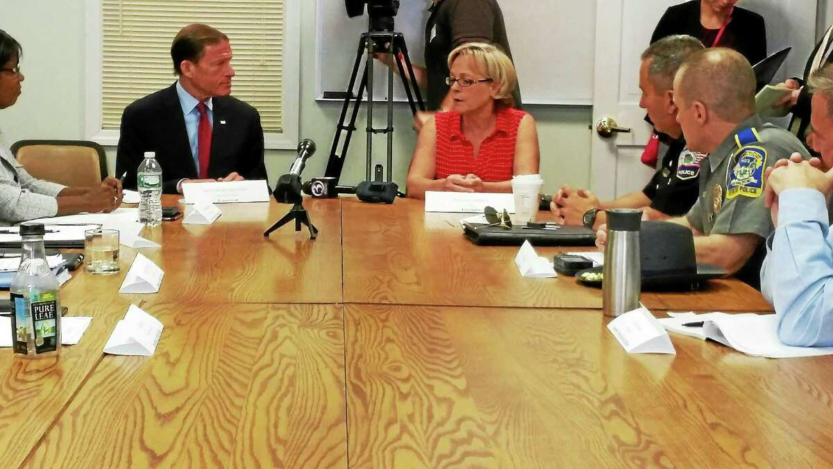 U.S. Sen. Richard Blumenthal, D-Conn., and Torrington Mayor Elinor Carbone discuss how to combat the rising number of heroin and opiate related deaths in the state on Monday.