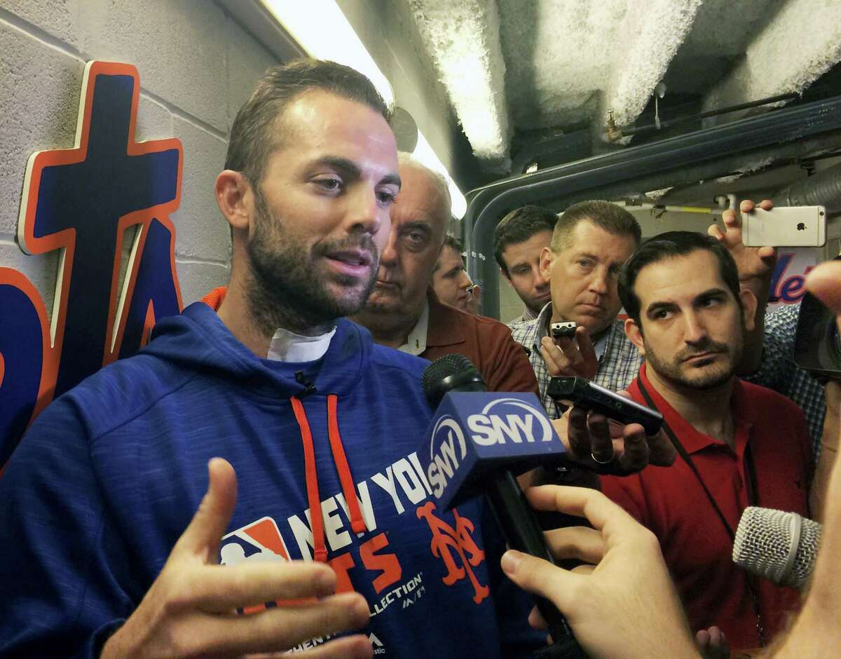 Mets third baseman David Wright speaks to the media before Friday's game against the Cubs.