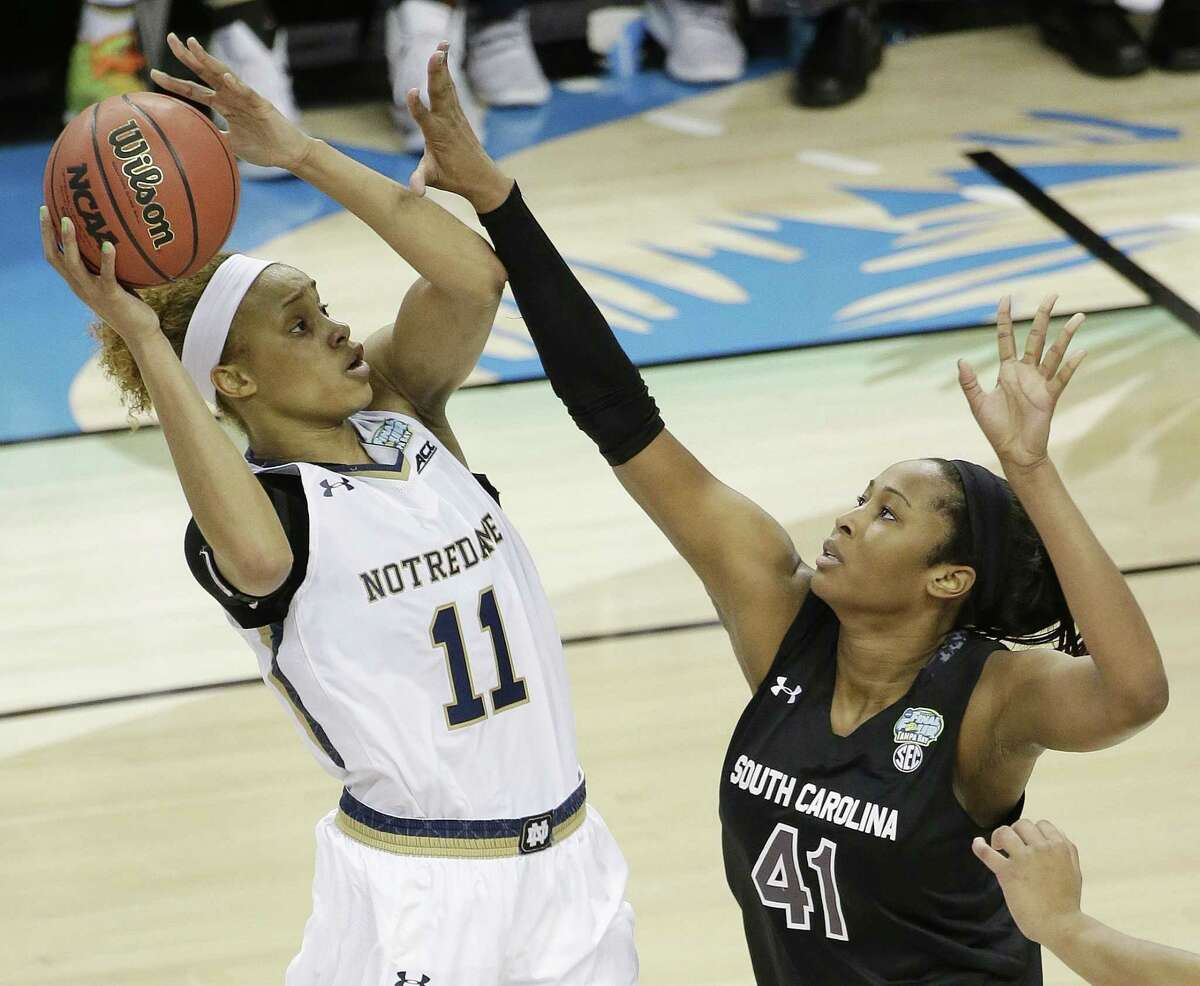 Notre Dame forward Brianna Turner (11) shoots against South Carolina center Alaina Coates (41) during the second half of the NCAA Women's Final Four tournament college basketball semifinal game, Sunday, April 5, 2015, in Tampa, Fla. Notre Dame won 66-65.