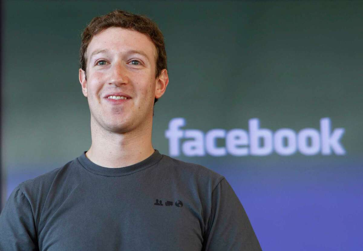 FILE - In this Jan. 3, 2011 file photo, shows Facebook CEO Mark Zuckerberg smiling in San Francisco. Zuckerberg turns 28 on Monday, May 14, 2012. He's considerably younger than the average FORTUNE 500 CEO, of course. But while some investors worry that Zuckerberg is too young to lead Facebook as a public company, experts point out that Bill Gates, Steve Jobs and Michael Dell were in their 20s when their companies had IPOs. (AP Photo/Paul Sakuma, File)