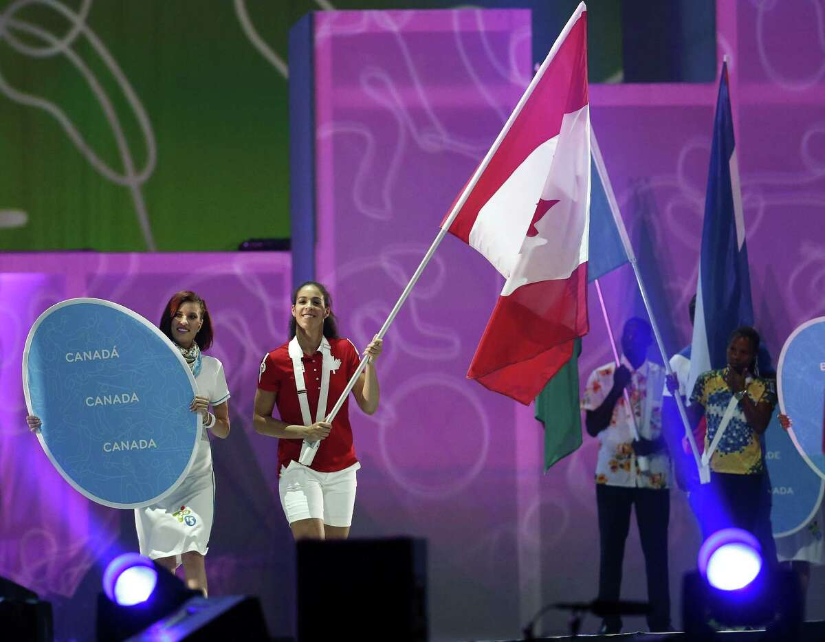 UConn basketball player Kia Nurse carries the Canadian flag during the parade of nations at the closing ceremony of the Pan Am Games on July 26 in Toronto.