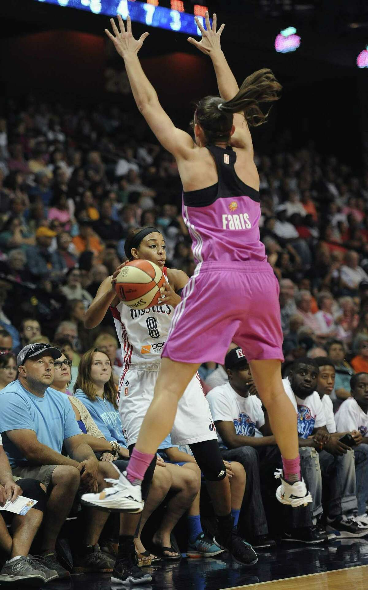 The Connecticut Sun's Kelly Faris pressures the Washington Mystics' Bria Hartley as she attempts to inbound the ball during Friday's game in Uncasville.