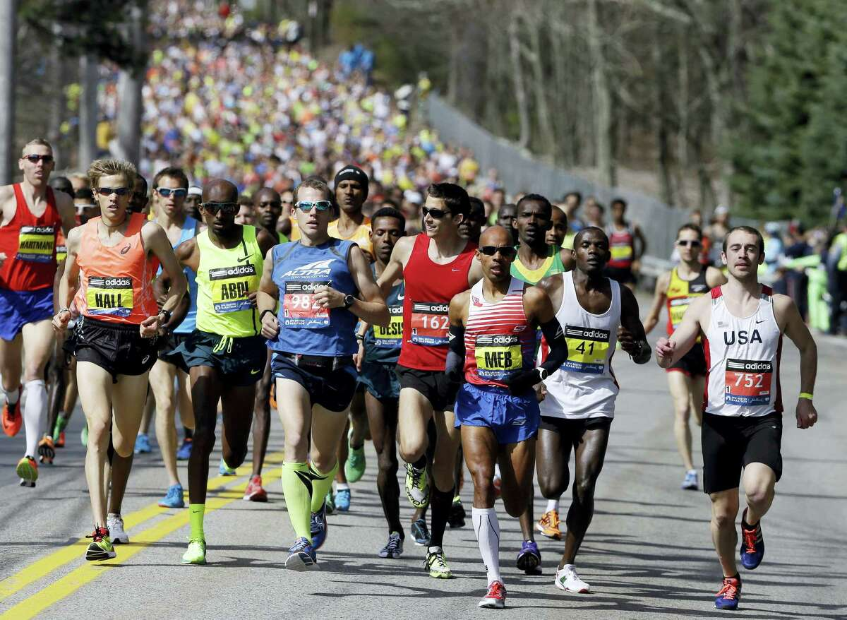 In this April 21, 2014 photo, runners compete in the 118th Boston Marathon in Hopkinton, Mass. The 120th running of the historic footrace is scheduled for Monday, April 18, 2016.