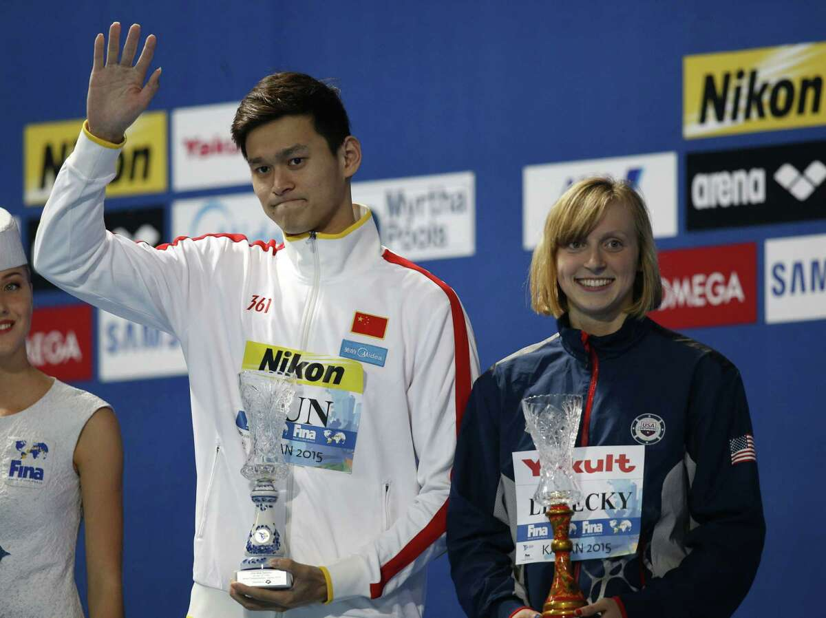 China's Sun Yang, left, and the United States' Katie Ledecky present the awards as best athletes of the competition Sunday at the end of the Swimming World Championships in Kazan, Russia.