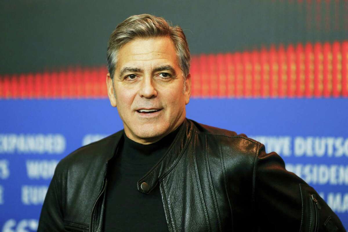 """In this Feb. 11, 2016 photo, actor George Clooney attends a news conference for the film """"Hail Caesar"""" at the 2016 Berlinale Film Festival in Berlin. Clooney hosted weekend fundraisers in California on behalf of Democratic presidential candidate Hillary Clinton."""