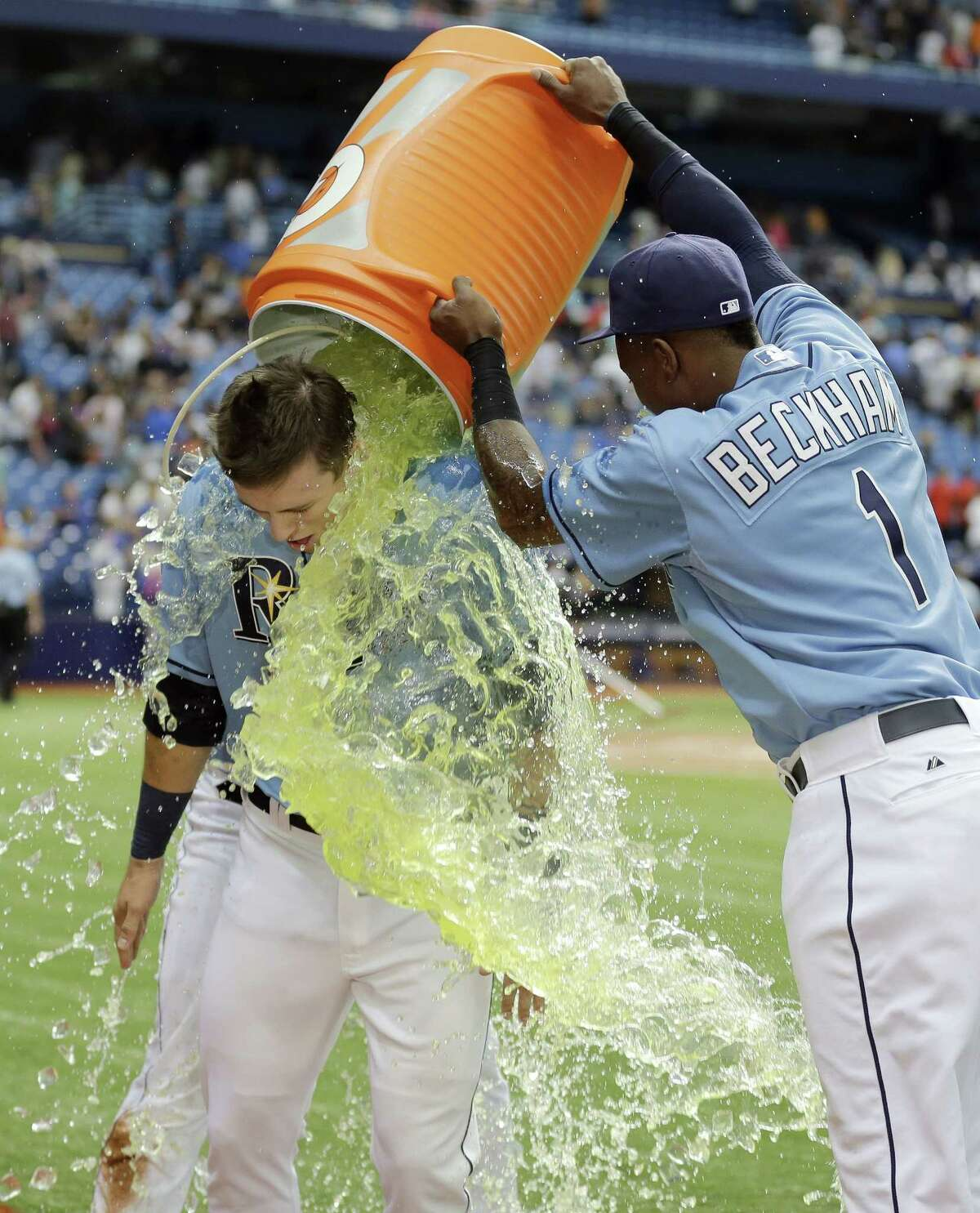 The Tampa Bay Rays' Tim Beckham douses Richie Shaffer with Gatorade after the Rays defeated the New York Mets 4-3 on Sunday in St. Petersburg, Fla.