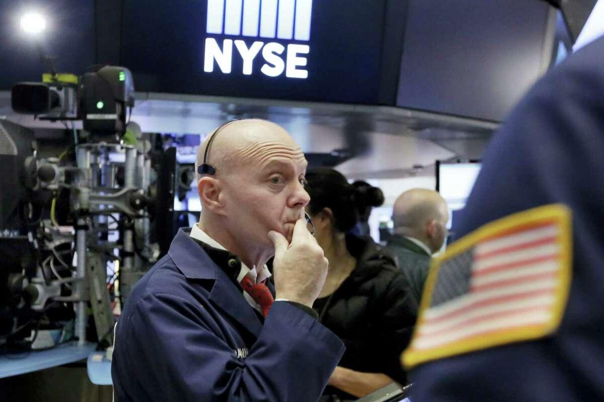 Trader Daniel Porin works on the floor of the New York Stock Exchange Wednesday.