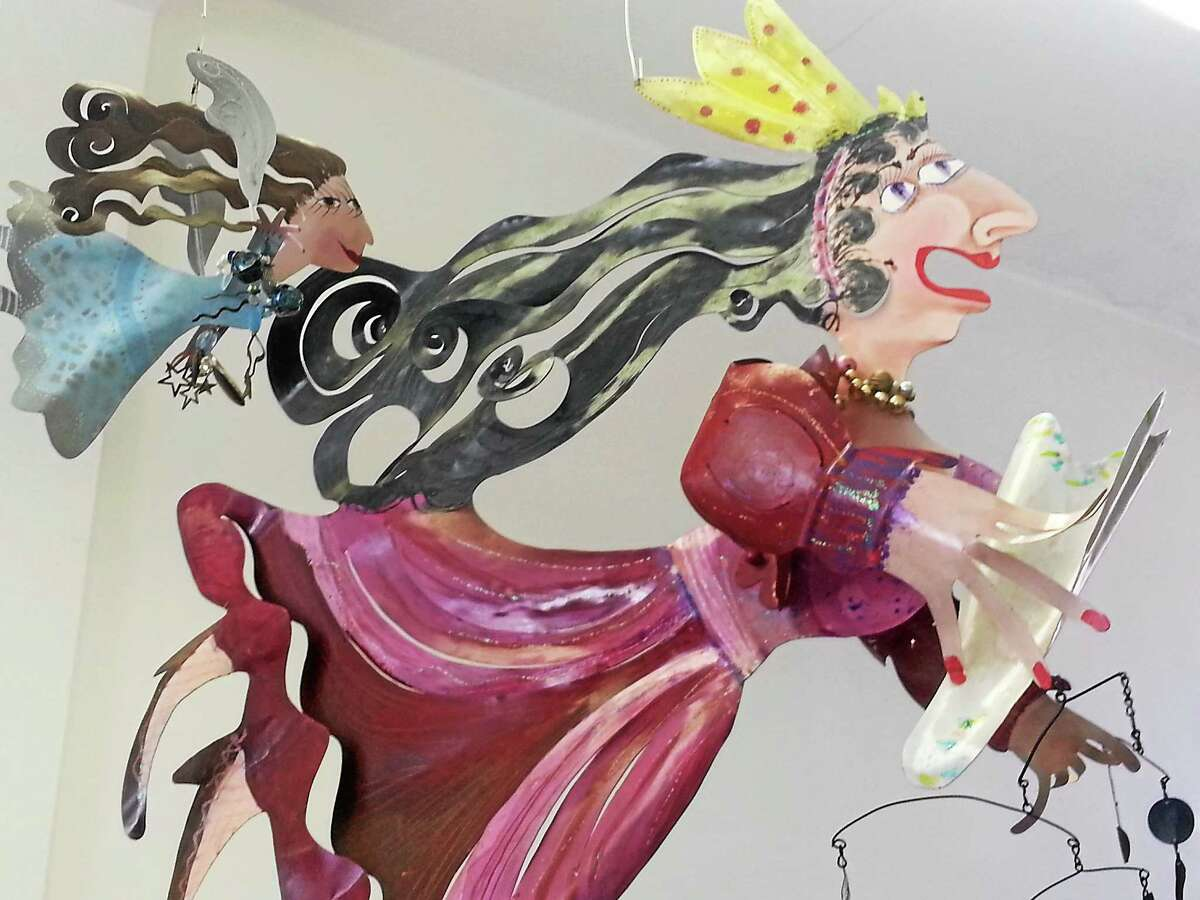 More large, metal figures seen hanging from the ceiling of Rossiís Torrington studio and showroom.