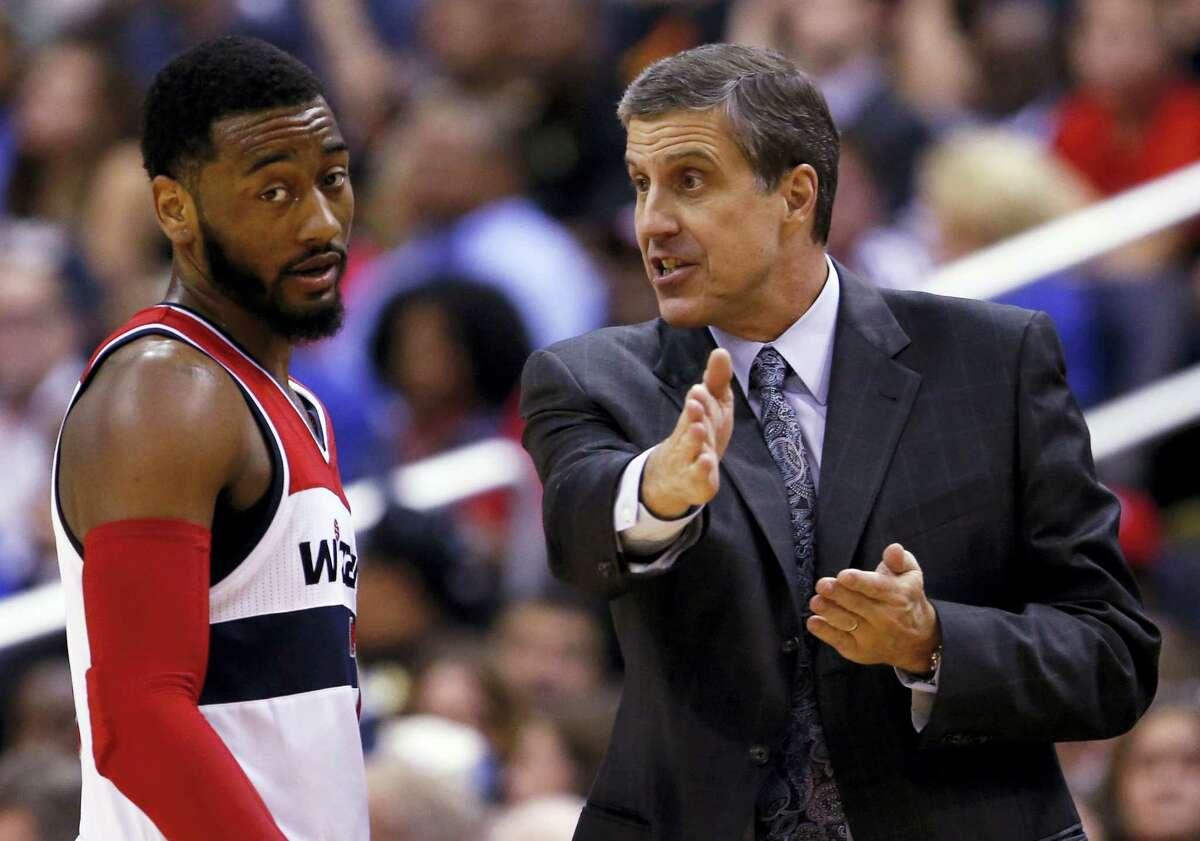 Washington Wizards guard John Wall listens to head coach Randy Wittman.