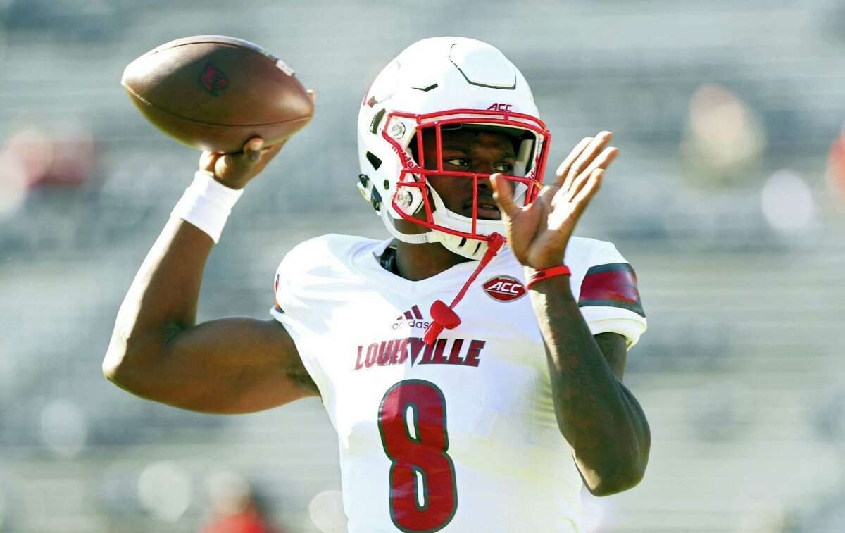 In a Saturday, Oct. 29, 2016 photo, Louisville quarterback Lamar Jackson (8) throws a pass during warmups before an NCAA college football game against Virginia in Charlottesville, Va. Jackson has become one of college football'Äôs most recognizable players the first two months of the season. He enters November as a prohibitive favorite to become Louisville'Äôs first Heisman winner.