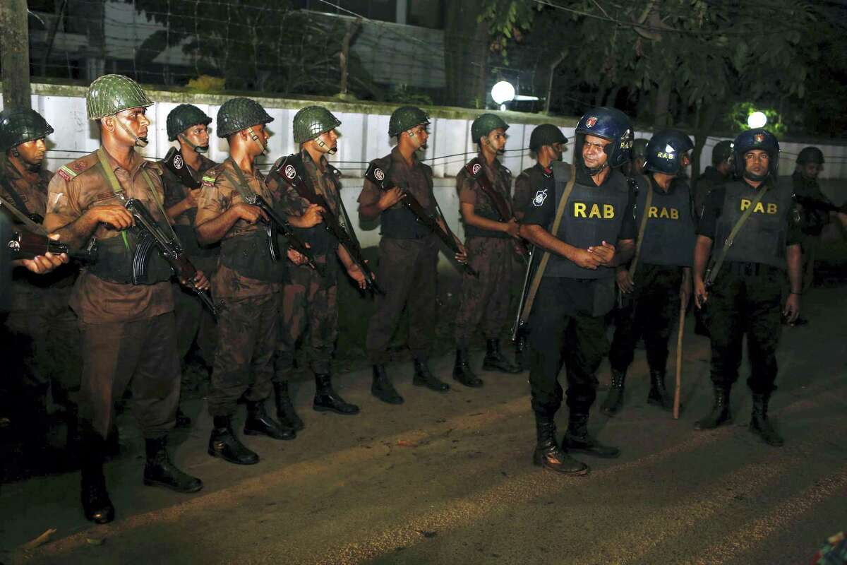 Bangladeshi security personnel cordon off the area after a group of gunmen attacked a restaurant popular with foreigners in a diplomatic zone of the Bangladeshi capital Dhaka, Bangladesh, Friday, July 1, 2016. A group of gunmen attacked the Holey Artisan Bakery in Dhaka's Gulshan area, taking hostages and exchanging gunfire with security forces, according to a restaurant staff member and local media reports.