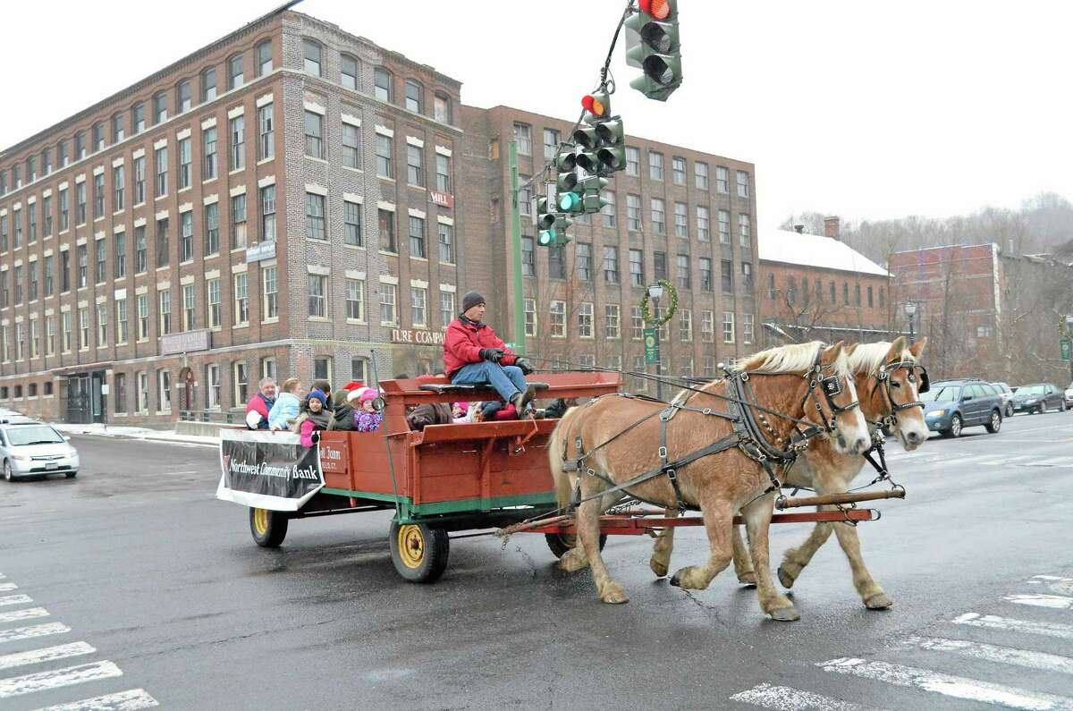 The horse-drawn carriage was one of the prime attractions at Winsted's Christmas on Main Street in 2012. Sponsored by the Friends of Winsted, the event included a visit from Santa Claus, live music from The Gilbert School and holiday specials at many of the stores along Main.