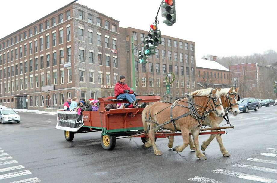 The horse-drawn carriage was one of the prime attractions at Winsted's Christmas on Main Street in 2012. Sponsored by the Friends of Winsted, the event included a visit from Santa Claus, live music from The Gilbert School and holiday specials at many of the stores along Main. Photo: Register Citizen File Photo