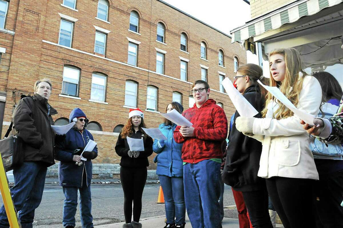 The Gilbert School Chorus sings carols during Winsted's Christmas on Main Street event in 2013.