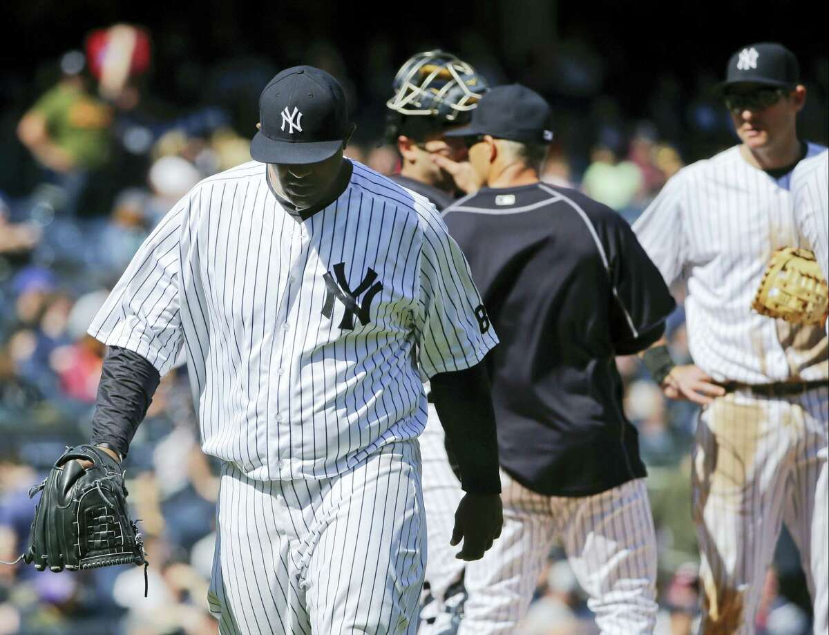 Yankees starting pitcher CC Sabathia, left, leaves the game during the fifth inning.