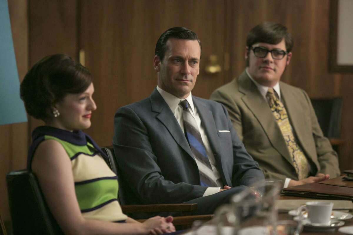 """Elisabeth Moss, from left, Jon Hamm and Rich Sommer appear in a scene from """"Mad Men."""""""
