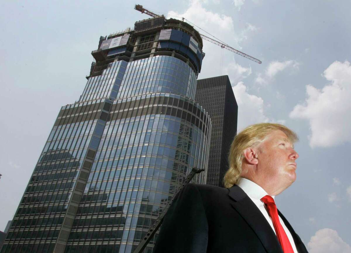 In this photo taken May 24, 2007, Donald Trump is profiled against his 92-story Trump International Hotel & Tower during a news conference on construction progress in Chicago.