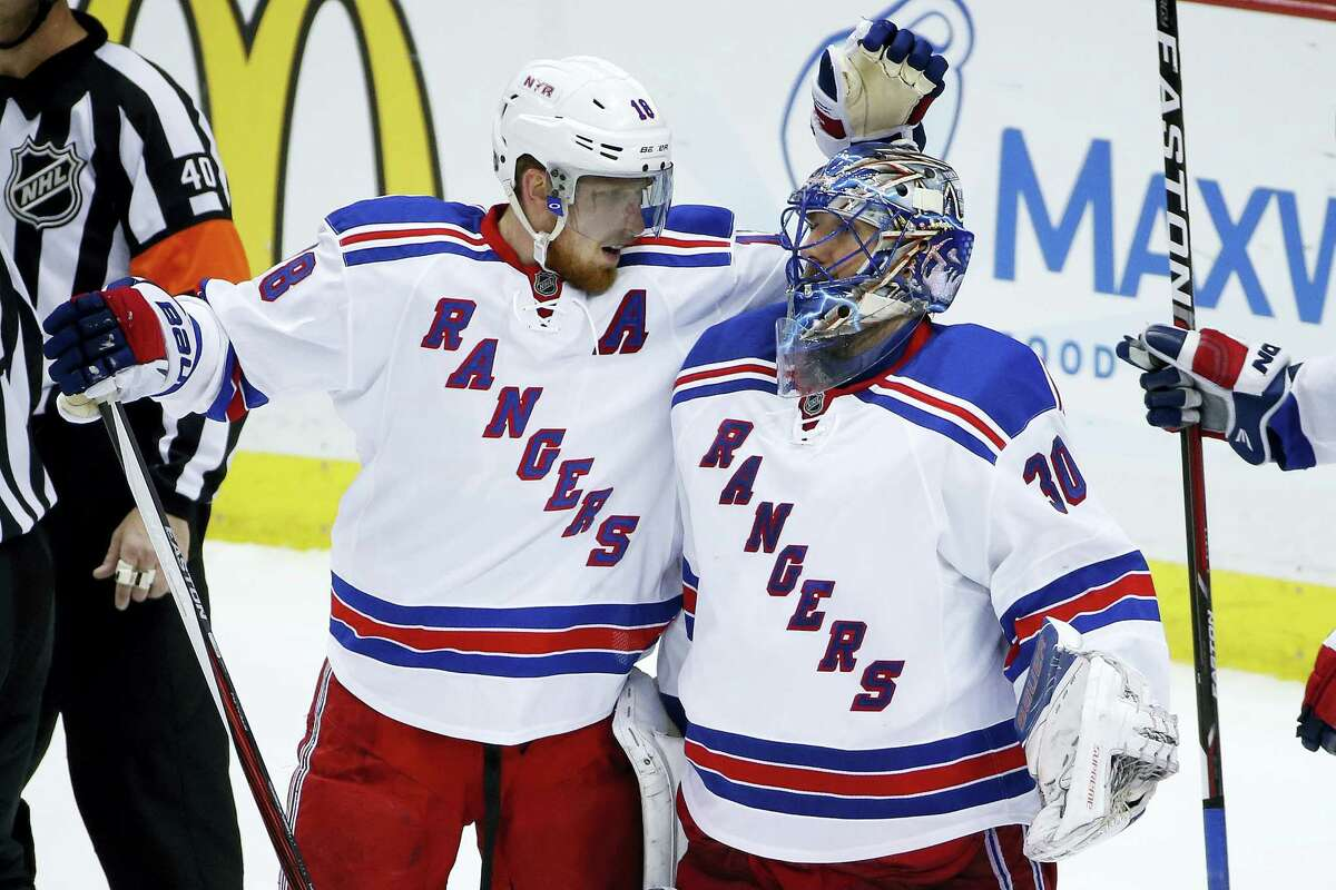 New York Rangers goalie Henrik Lundqvist, right, celebrates a 4-2 win over the Penguins with Marc Staal on Saturday.