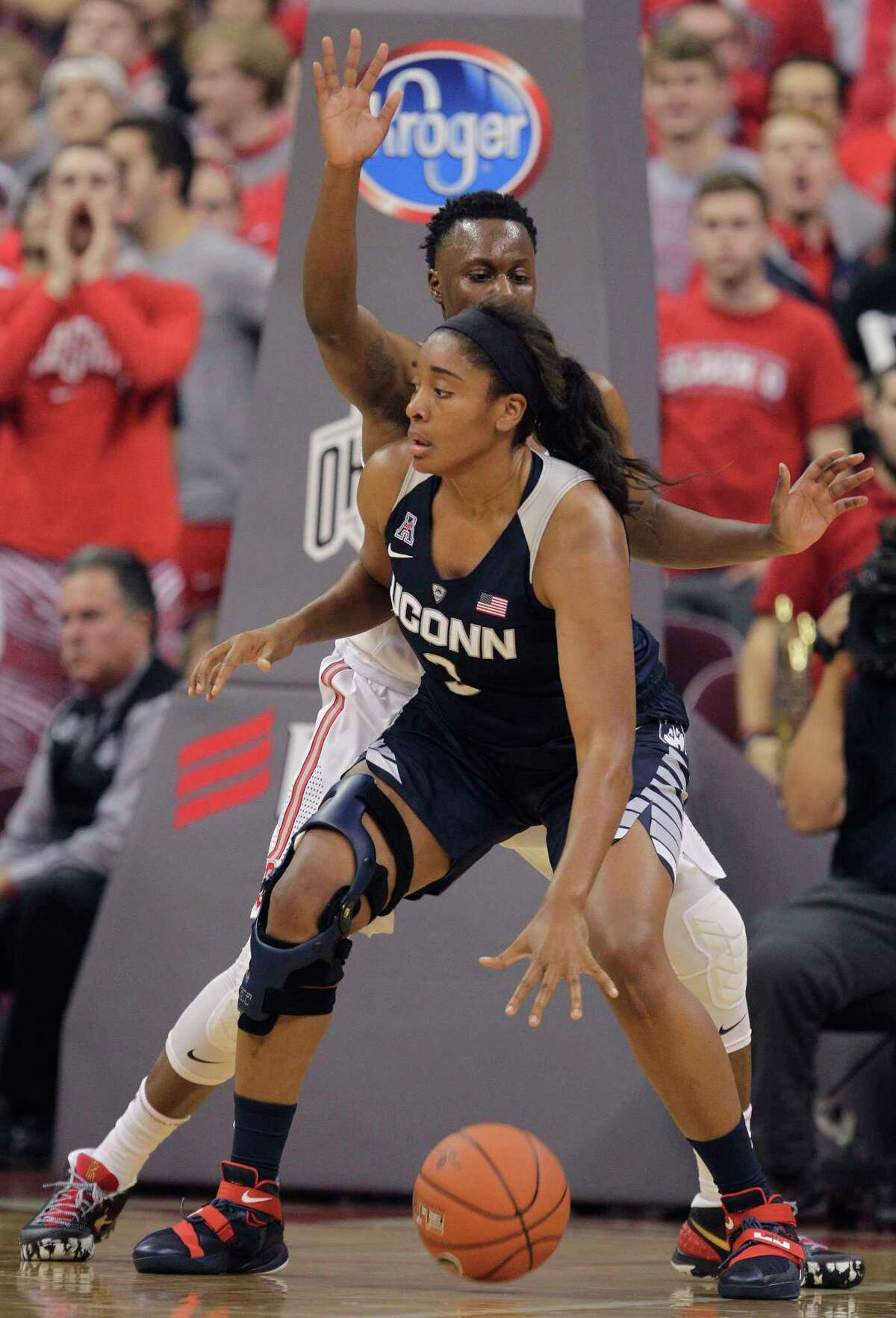 UConn's Morgan Tuck posts up Ohio State's Shayla Cooper during a Nov. 16 game in Columbus.