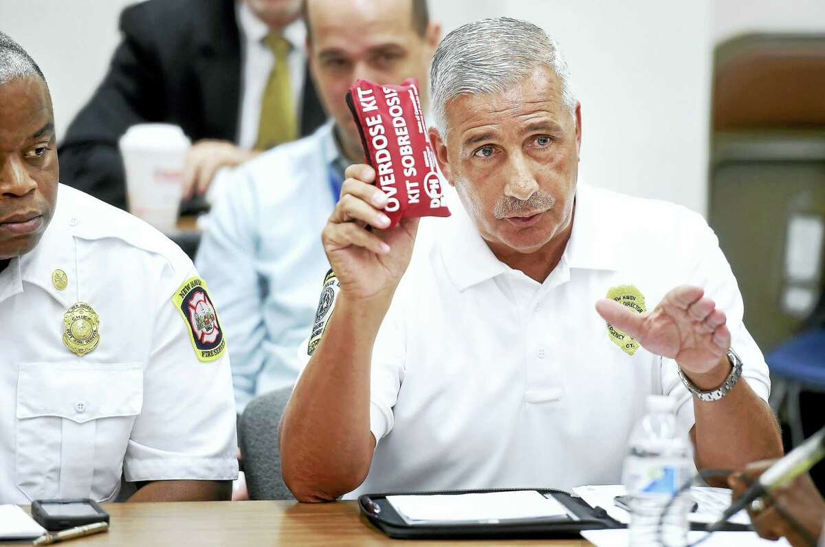Rick Fontana, deputy director of emergency operations at the city Office of Emergency Management and Homeland Security, holds up an overdose kit while making a point at a roundtable discussion about efforts to curb the opioid epidemic at the New Haven Police Department on Friday.