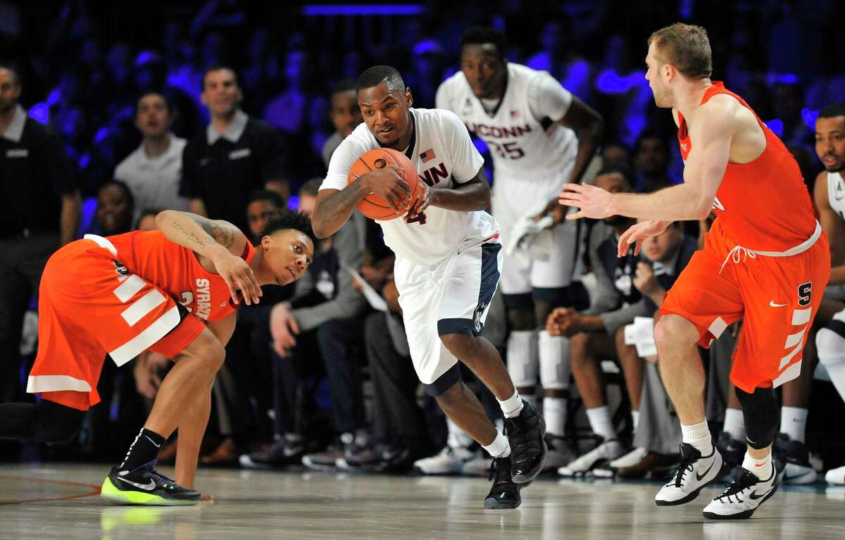 UConn guard Sterling Gibbs picks up a steal between Syracuse guards Malachi Richardson (23) and Trevor Cooney (10) during Thursday's game in the Bahamas.