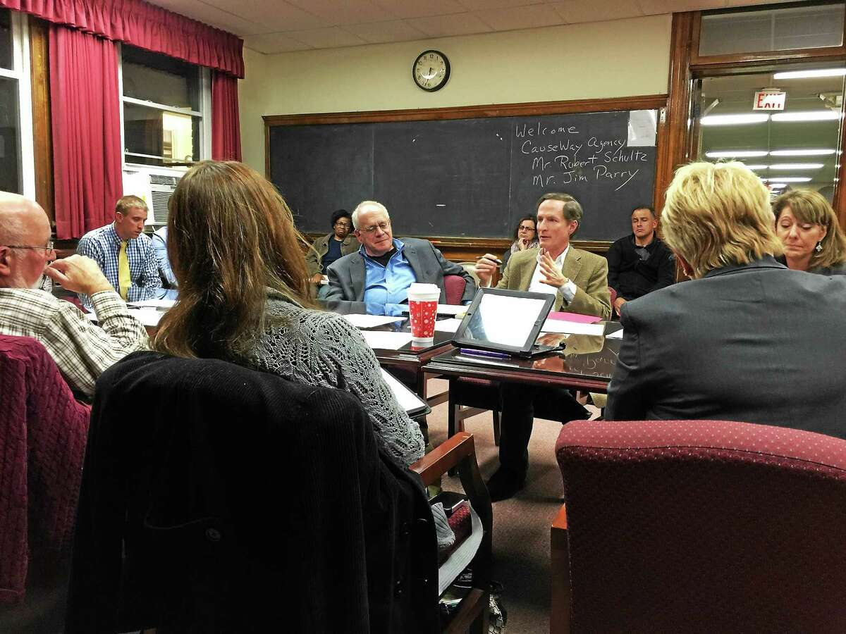 Robert Schultz and Jim Parry of The CauseWay Agency speak with members of the Torrington High School community Monday evening.