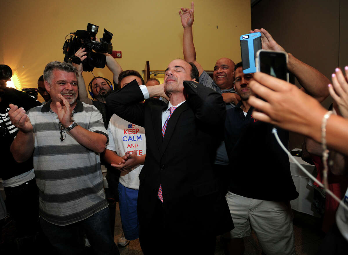 In this Sept. 16 file photo, former Bridgeport Mayor Joseph Ganim reacts after he enters Testo's Restaurant in Bridgeport, after winning the Democratic mayoral primary. Ganim is scheduled to take the oath of office Tuesday.
