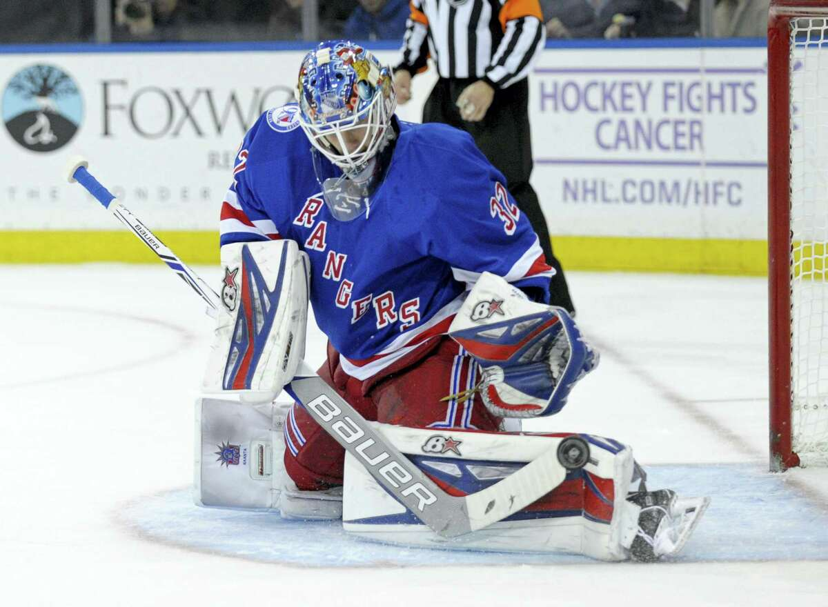 New York Rangers goaltender Antti Raanta deflects the puck during the first period against the Vancouver Canucks.