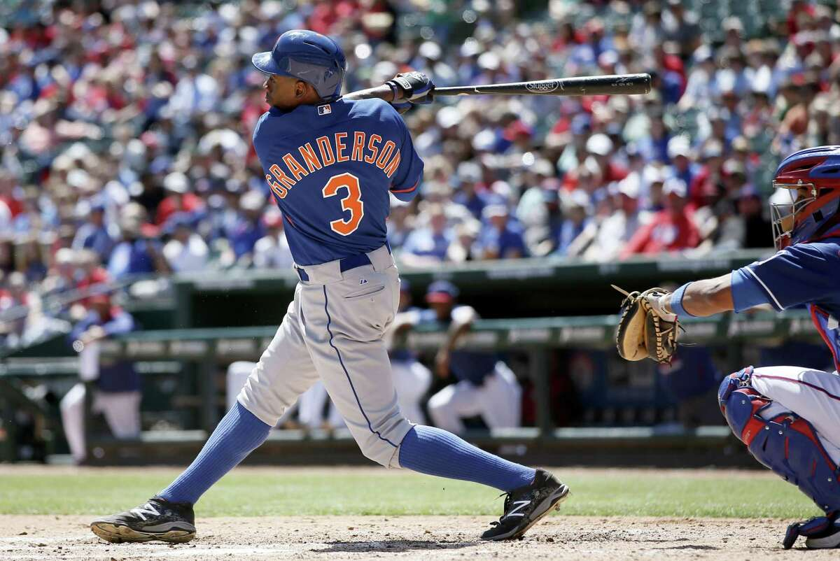 New York Mets outfielder Curtis Granderson follows through on a single up the middle in the fourth inning of Saturday's tie against the Rangers in Arlington, Texas.