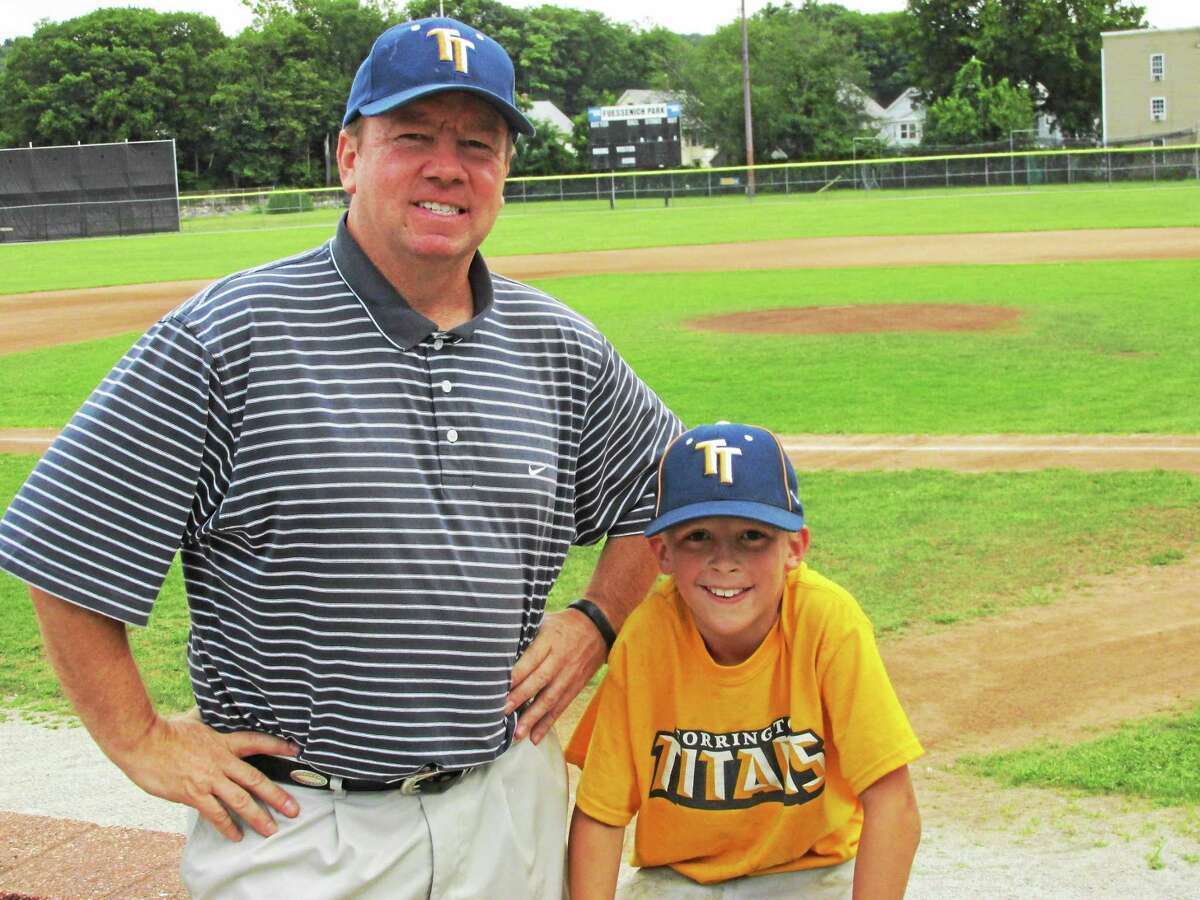 Submitted Newly-promoted Titans president Chris Myslow stands with Titans batboy Mo Beland at Fuessenich Park, presenting a sunny view of the Titans' future.
