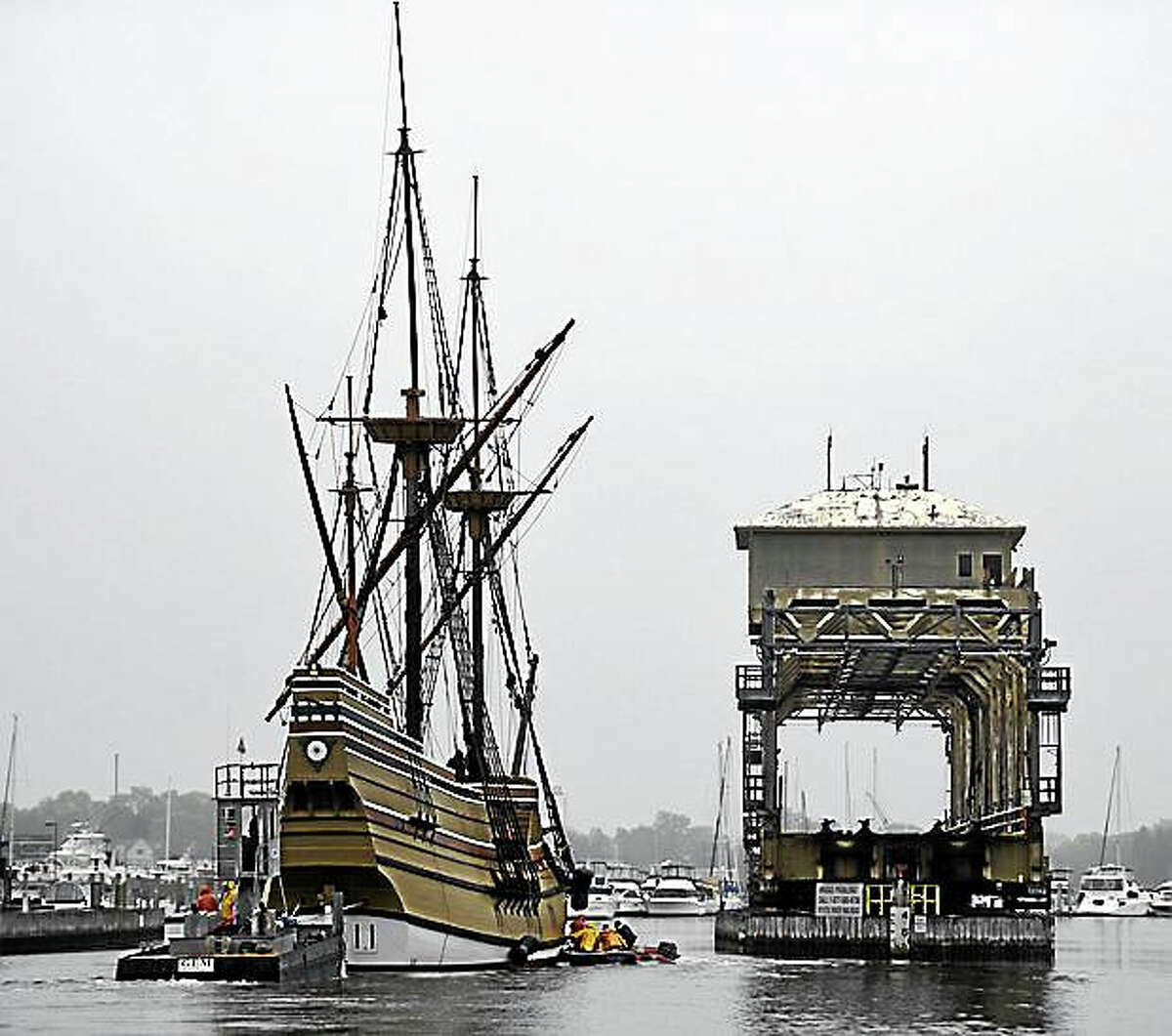 Mayflower II being towed in the Mystic River, past the Mystic River Bridge