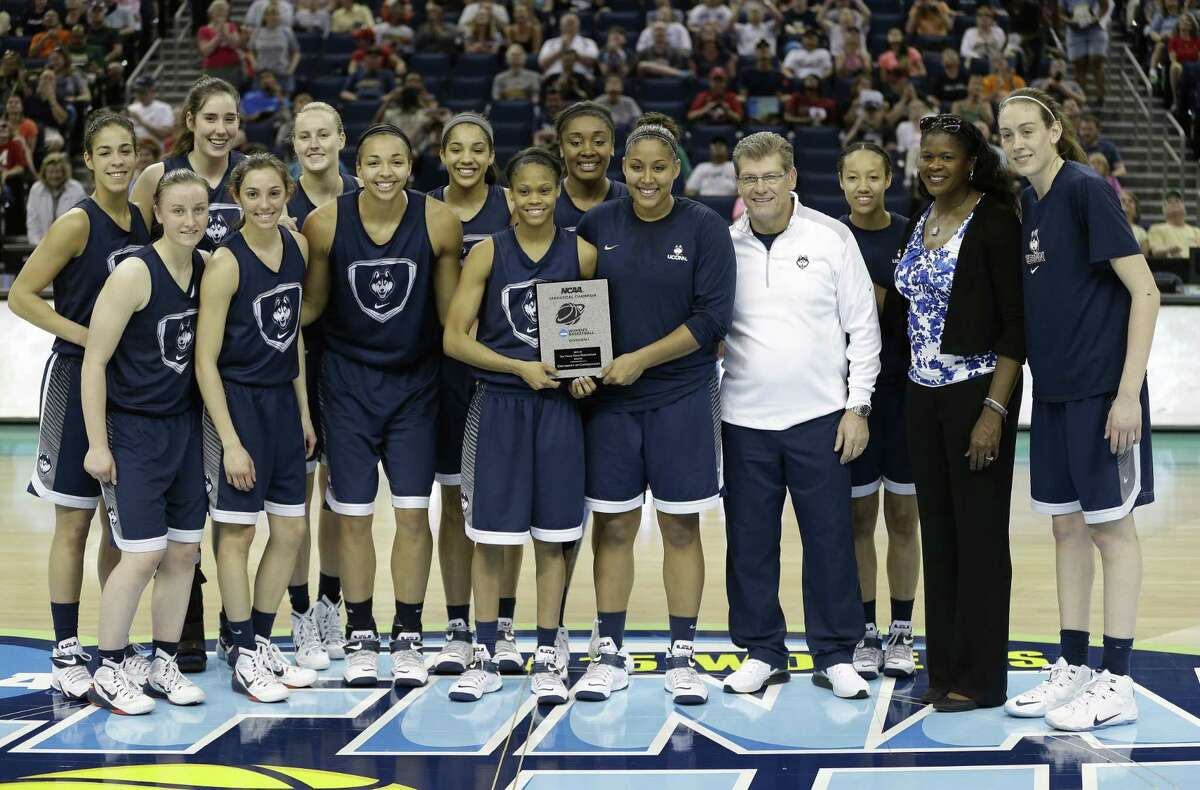 UConn poses for a photo after winning the NCAA Statistical Champion trophy for top field goal percentage on Saturday in Tampa, Fla.