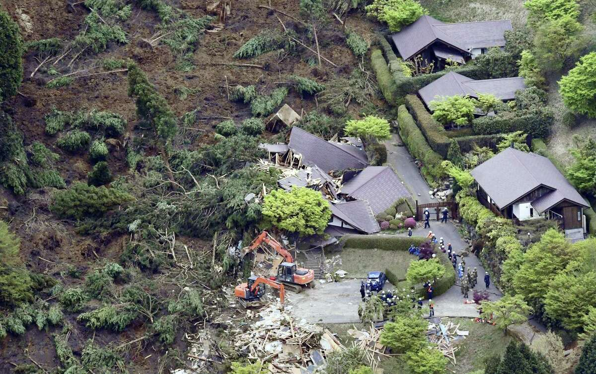 Buildings are collapsed by a landslide caused by an earthquake in Minamiaso village, Kumamoto prefecture, Japan, Saturday, April 16, 2016. The powerful earthquake struck southwestern Japan early Saturday, barely 24 hours after a smaller quake hit the same region.