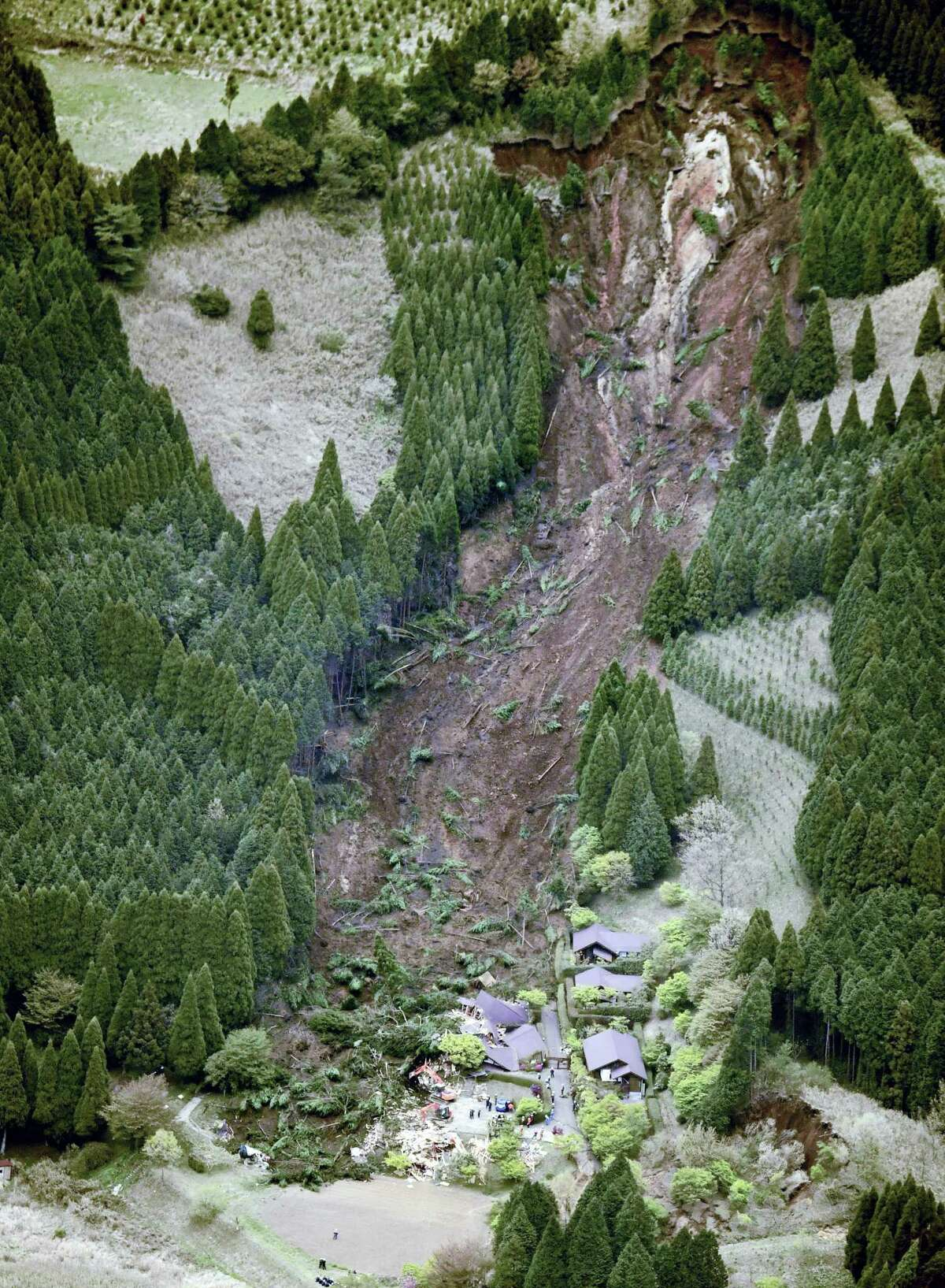 Buildings are collapsed by a landslide caused following a powerful earthquake in Minamiaso village, Kumamoto prefecture, Japan, Saturday, April 16, 2016. The powerful earthquake struck southwestern Japan early Saturday, barely 24 hours after a smaller quake hit the same region.