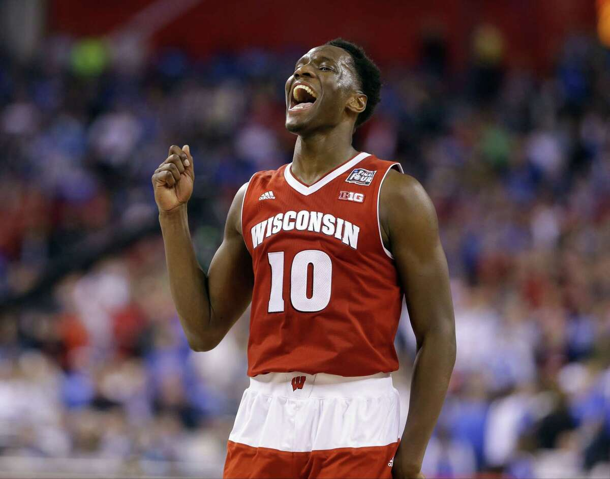 Wisconsin's Nigel Hayes celebrates at the end of an NCAA Final Four tournament college basketball semifinal game against Kentucky Saturday, April 4, 2015, in Indianapolis. Wisconsin won 71-64. (AP Photo/Michael Conroy)