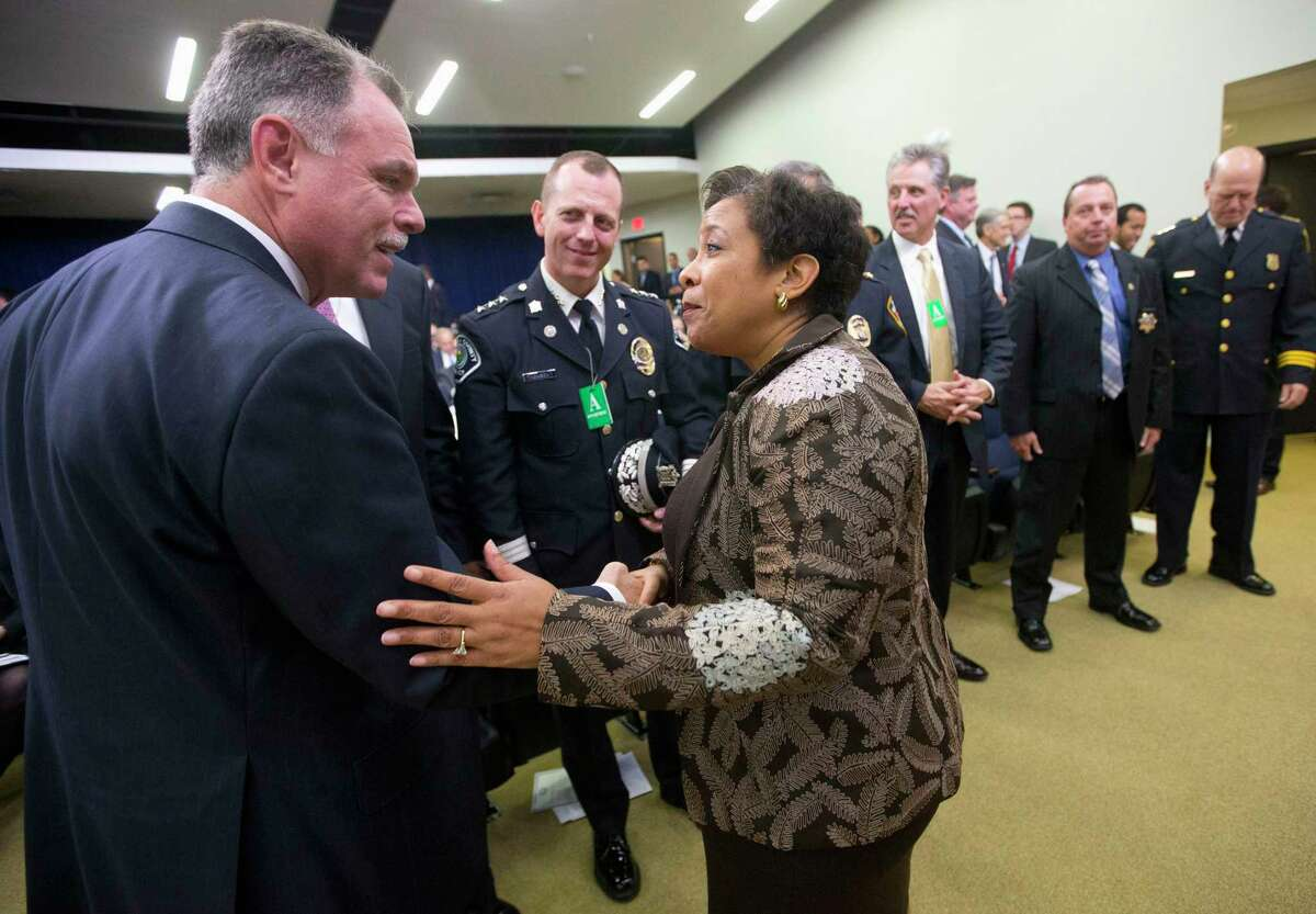 In this Oct. 22, 2015, file photo, Attorney General Loretta Lynch greets Chicago Police Superintendent Garry McCarthy in the Old Executive Office Building on the White House complex in Washington. Chicago Mayor Rahm Emanuel has fired McCarthy after a public outcry over the handling of the case of a black teenager shot 16 times by a white police officer.
