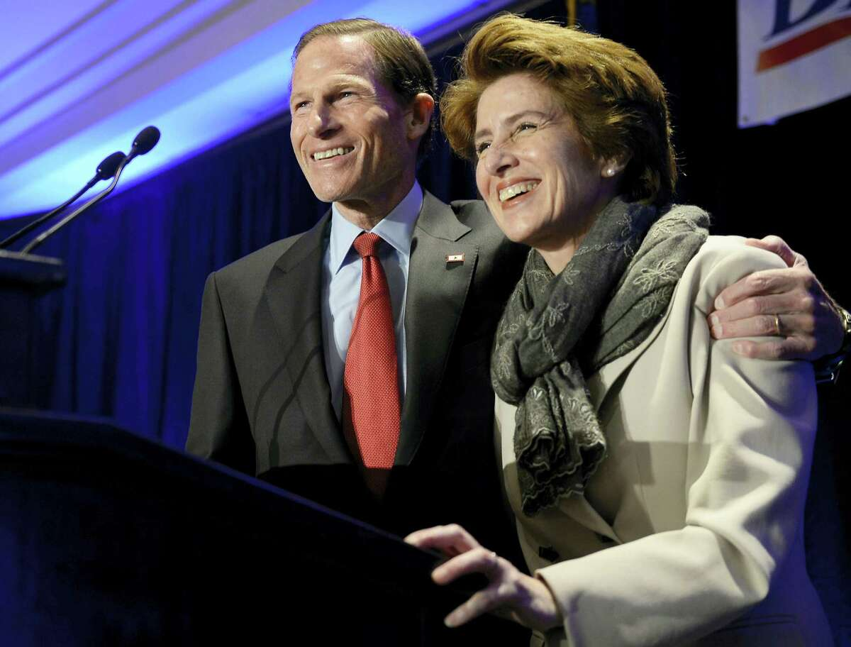 U.S. Sen. Richard Blumenthal, D-Conn., accompanied by his wife, Cynthia, addresses supporters at an election night rally celebrating his victory Tuesday in Hartford.