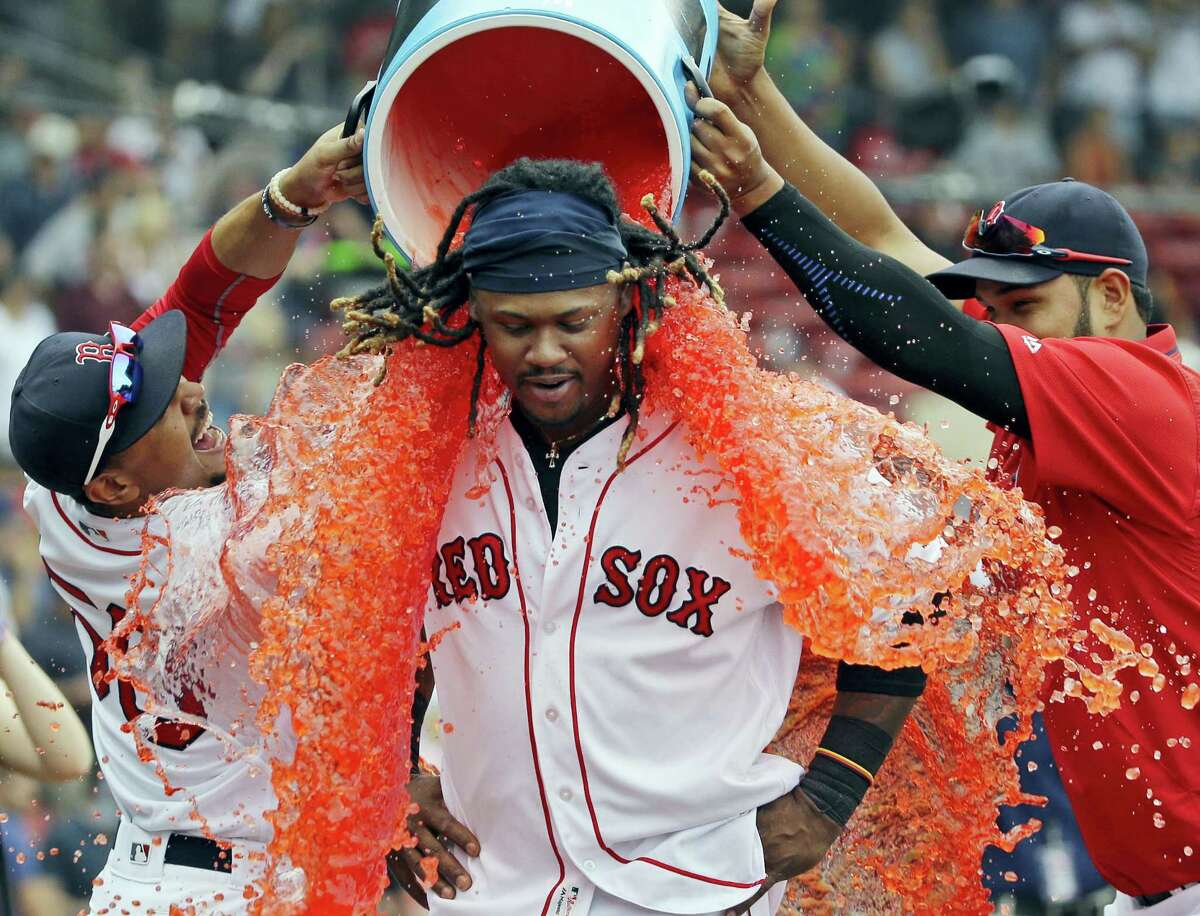 Boston's Hanley Ramirez is doused by teammates Mookie Betts, left, and Eduardo Rodriguez after they defeated the Tampa Bay Rays.