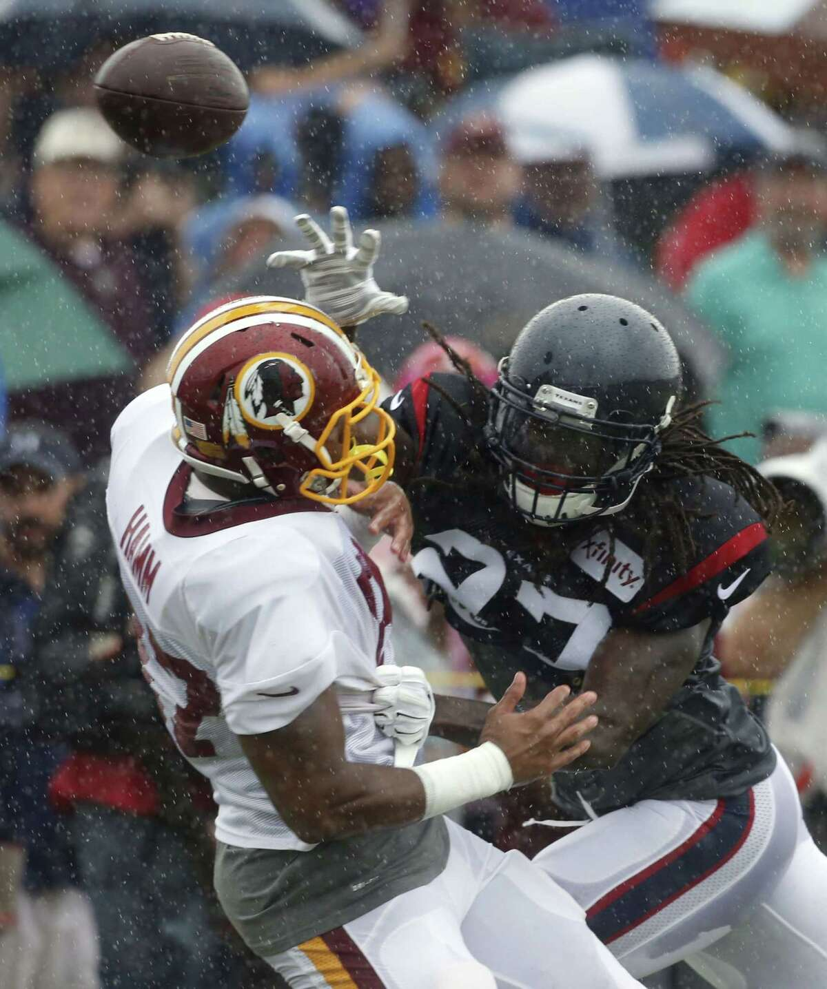 The Houston Texans' Stevie Brown, right, knocks away a pass intended for Washington's Je'Ron Hamm during training camp on Saturday in Richmond, Va.