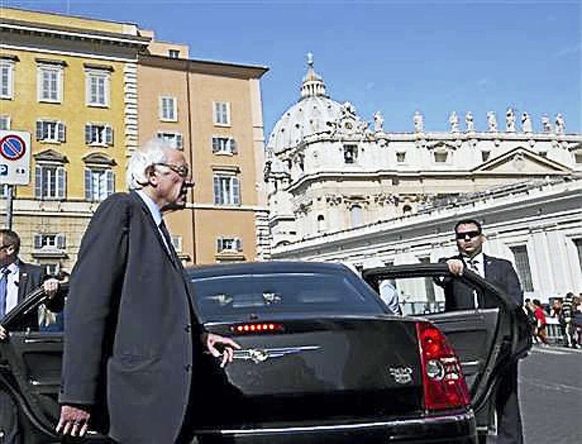 US presidential candidate Bernie Sanders arrives on a hotel terrace near the Vatican to meet reporters, Saturday, April 16, 2016. Democratic presidential candidate Bernie Sanders says in an interview with The Associated Press that he met with Pope Francis. Sanders says the meeting took place Saturday morning before the pope left for his one-day visit to Greece. He says he was honored by the meeting, and that he told the pope he appreciated the message that he is sending the world about the need to inject morality and justice into the world economy. Sanders says it's a message he has been sending as well.